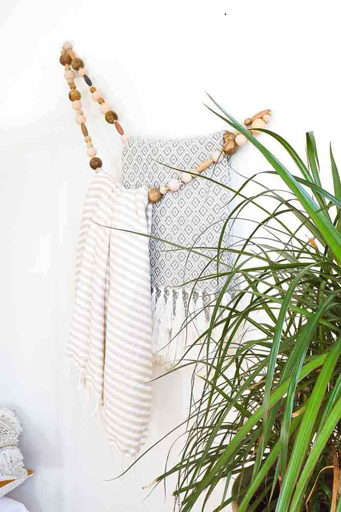 Minimal Beaded Blanket Holder. Love this idea and it would look very stylish in any room. Sugar and Cloth show you how to make a minimal beaded blanket holder.Please share. Make Mondays more manageable and sign up for our craft inspiration newsletter. Delivered to your inbox - CraftyLikeGranny.com #DIY #Craft