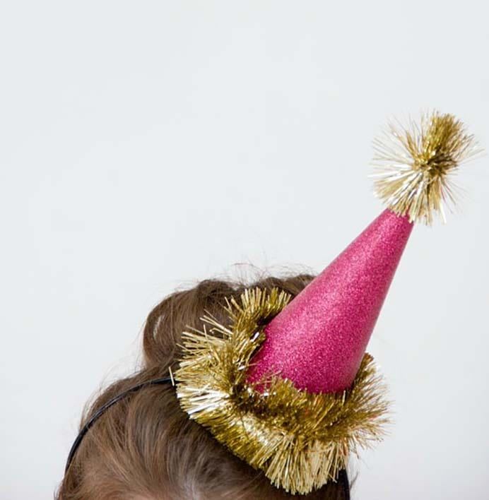 DIY Glitter Holiday Party Hats. Keeping with the theme of glitter, these DIY New Year hats are gorgeous. Choose whatever color glitter works for you. Follow Kelly's tutorial on Studio DIY. Please share. The best in craft delivered to your inbox every Monday - CraftyLikeGranny.com #newyears #newyearseve #diycrafts