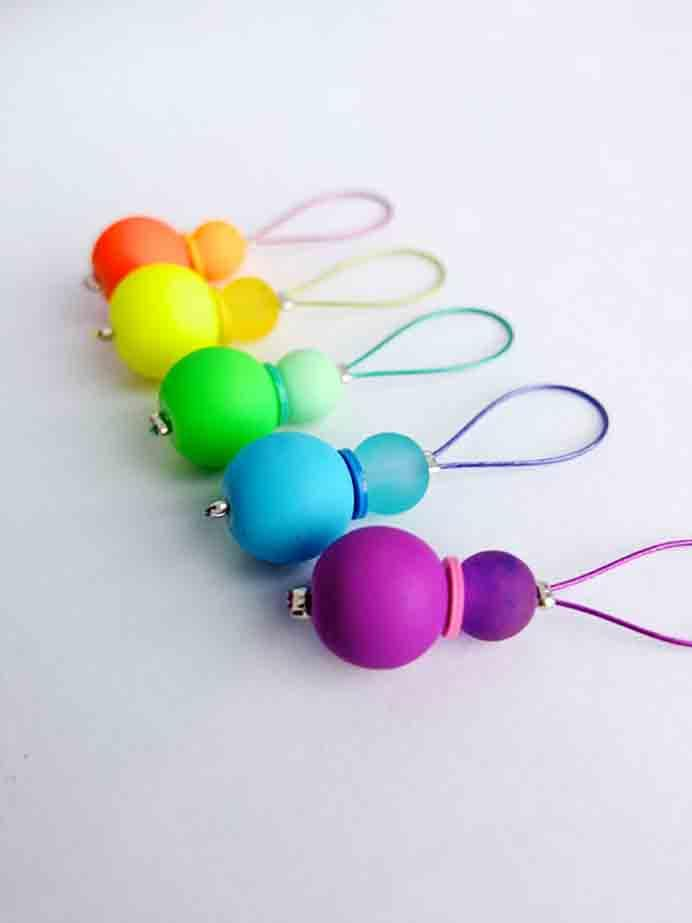 DIY Rainbow Stitch Markers. These look so cheery and fun. Follow My Poppet's tutorial on how to make Rainbow Stitch MarkersPlease share. Make Mondays more manageable and sign up for our craft inspiration newsletter. Delivered to your inbox - CraftyLikeGranny.com #knitting #Stitchmarkers