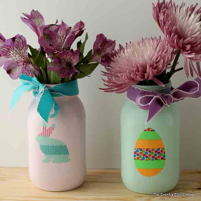 Easter Mason Jars. A clever way to use up washi tape and make your own Easter themed stickers. Angie from The Country Chic Cottage steps you through what to do in her tutorial for Easter Mason Jars. Please share. Join now for creative craft inspiration. The best in craft delivered to your inbox every Monday - CraftyLikeGranny.com #EasterCrafts #crafts #DIY