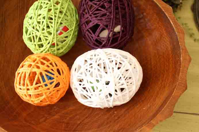 Yarn Egg Surprise Tutorial. Using some left over yarns would be a good idea for this project. Tiffany at Simply Modern Mom has a tutorial to make yarn eggs with a little surprise inside. Please share and make Mondays fun, get our craft inspiration delivered to your inbox - CraftyLikeGranny.com #EasterCrafts #yarn #kidscraft