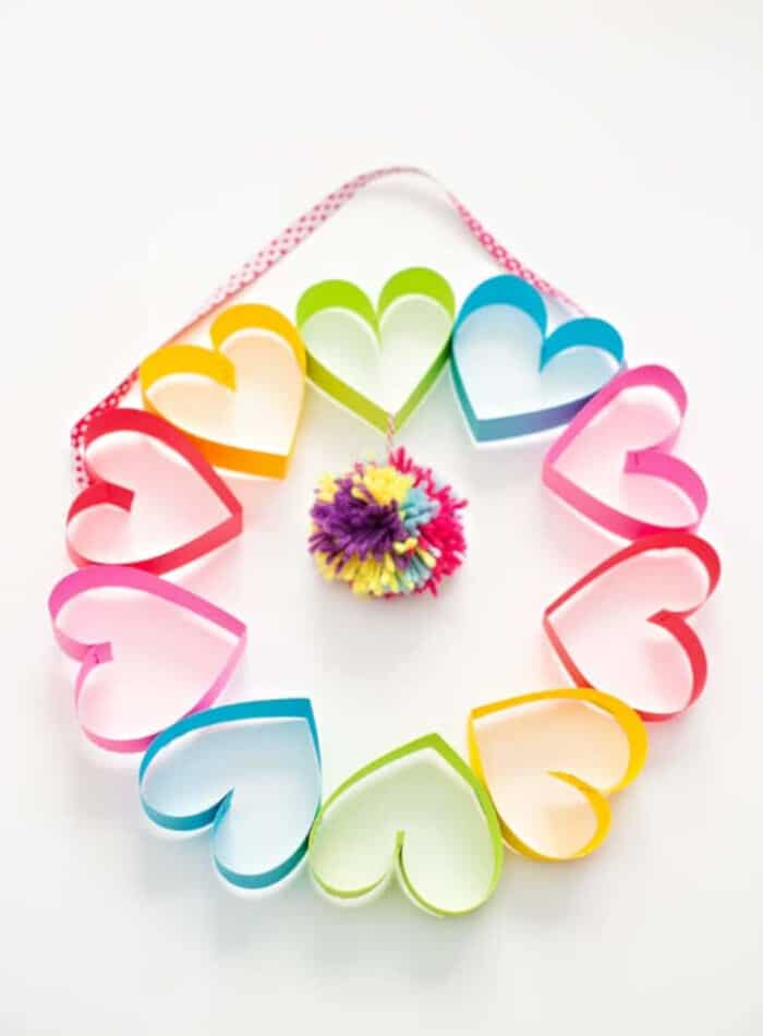 DIY Rainbow Paper Heart Pom Pom Wreath by Hello Wonderful