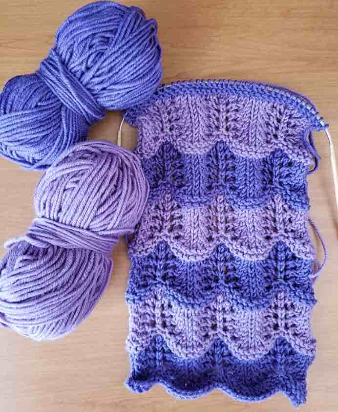 On My Needles. Crest Of The Wave Lace Stitch Scarf Update. Coming along slowly and sneaking in a bit of knitting when I can. Please share. Join now for creative craft inspiration. The best in craft delivered to your inbox every Monday - CraftyLikeGranny.com #knitting #knittingpattern #knit_guru