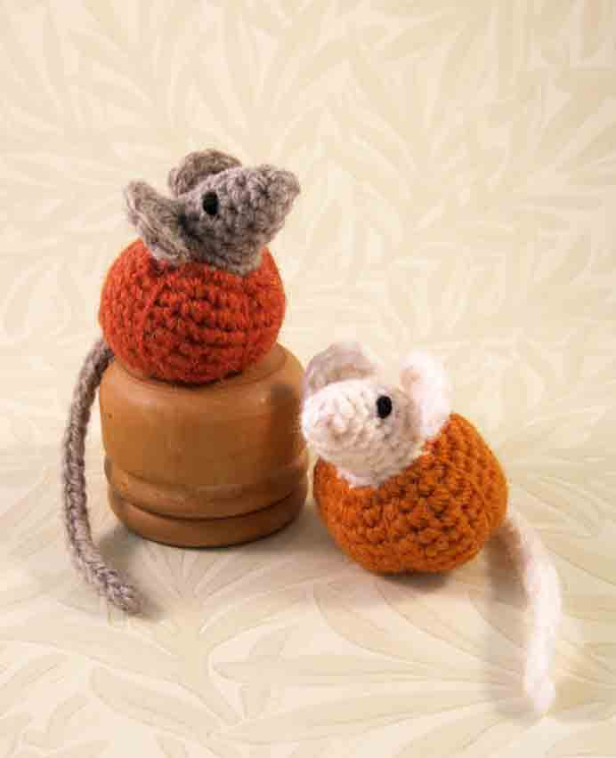 Cheeky Little Mice. These adorable mice look like they have chewed their way through a pumpkin! Follow Lucy's crochet pattern to make them. Please share. You will always look forward to Mondays, with our craft inspiration roundups -CraftyLikeGranny.com #PumpkinCrafts #crochet #amigurumi