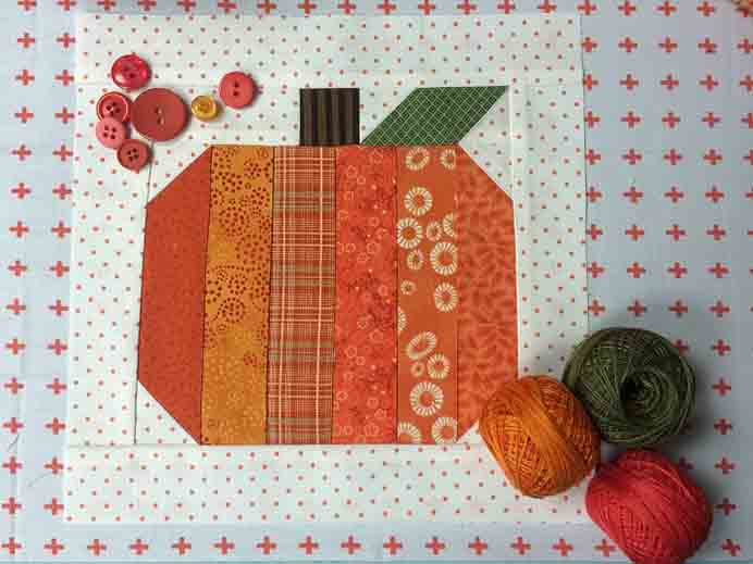 Quilting Block Sewn In A Snap! Follow Dianne Knott's quilting tutorial to create this simple pumpkin themed blocks. Using strips it's quick to put together and looks great! Please share. Join now for creative craft inspiration. The best in craft delivered to your inbox every Monday - CraftyLikeGranny.com #pumpkincrafts #quiltblock
