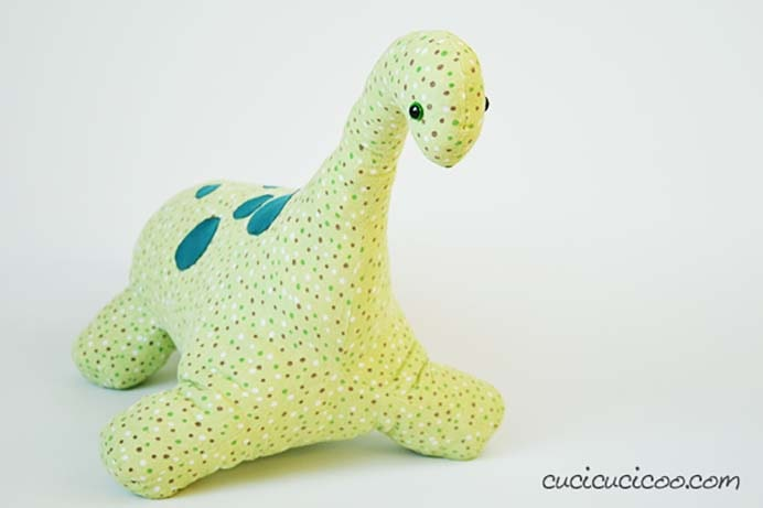 Gigantic Stuffed Dinosaur Pattern Review by Lisa at Cucicucicoo. Lisa from Cucicucicoo knew that her son would love this gigantic stuffed dinosaur pattern, that she found on Pinterest. Lisa shares what went well and what didn't go so well in her sewing experience of this pattern. Lisa gives some extra guidance, which is really helpful. Please share. Join now for creative craft inspiration. The best in craft delivered to your inbox every Monday - CraftyLikeGranny.com #dinosaurcrafts #sewingtutorial #sewingpattern