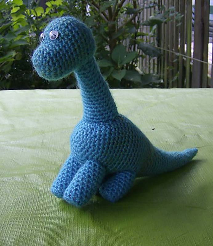 Meet Dudly. Dudly is an easy arigurumi pattern and is available as a free pattern Ravelry download by Marleen Hartog. Thanks Marleen, Dudly the Dinosaur is so cute. A perfect idea for a crocheted softie gift. Please share. Join now for creative craft inspiration. The best in craft delivered to your inbox every Monday - CraftyLikeGranny.com #dinosaurcrafts #amigurumi #crocheting