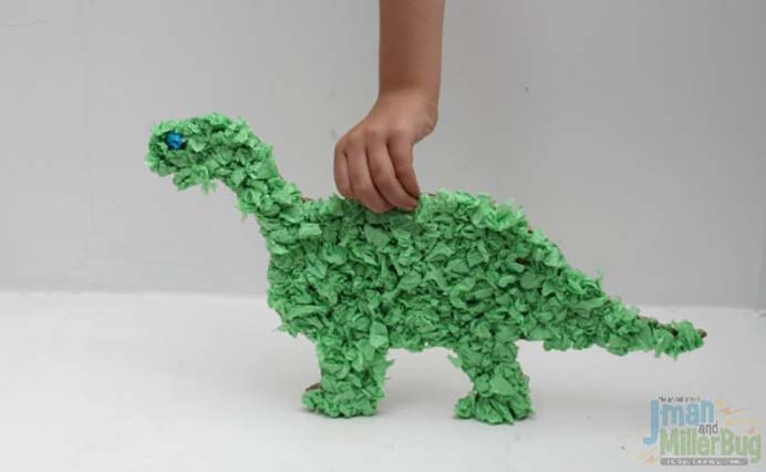 One For The Kids. A perfect activity for some craft time with your young Dinosaur fans. A easy craft to do for kids and creating the the green tissue paper balls is calming and looks so effective. Follow Jeanette's tutorial on Mom Unleashed. Please share and make Mondays fun, get our craft inspiration delivered to your inbox - CraftyLikeGranny.com #dinosaurcrafts #craftsforkids #papercraft