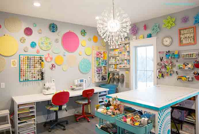Clever Ideas For Sewing Spaces. The couple of craft tables in Mandy from Sugar Bee Crafts are a clever use of space. There is a table where she can stand and cut out materials and another where both her sewing machine and overlocker are permanently set up. So much color going on! Please share. You will always look forward to Mondays, with our craft inspiration roundups -CraftyLikeGranny.com #crafttable #craftroom #sewing