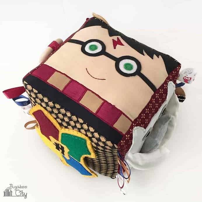 Harry Potter Baby Activity Cube Tutorial. The design on each side of this Baby Activity cube is all about 'Harry'. It is fun to do as you get to do a little of everything – embroidery, applique, and basic sewing. Take a look at Kim's tutorial on Bugaboo City. Please share. You will always look forward to Mondays, with our craft inspiration roundups -CraftyLikeGranny.com #harrypottercrafts #sewing #craft