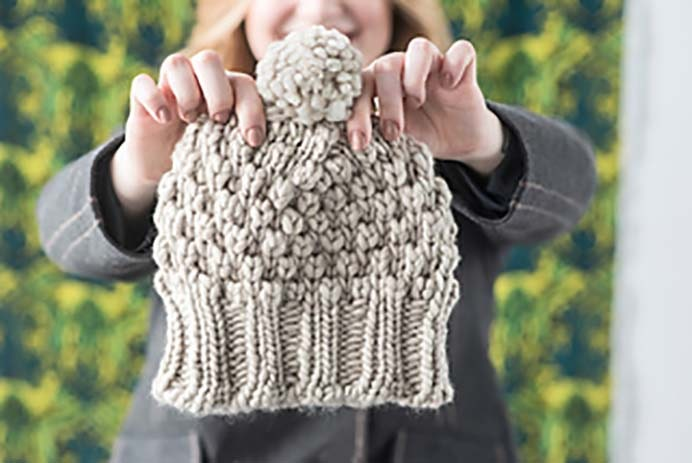 Kim's Pinecone Hat. Kirsten Kapur's knitted hat design was inspired by her friend; Kim's love of Pine Cones. Find her paid pattern on Ravelry. Please share. You will always look forward to Mondays, with our craft inspiration roundups -CraftyLikeGranny.com #pineconecraft #knittingpattern #knitting
