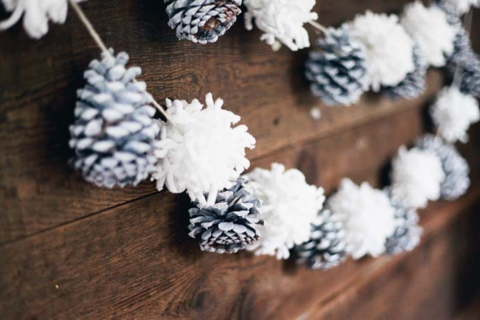 Pinecone and Pom Pom Garland. Tegan and Lindsay from Treasures and Travel made an easy garland DIY that you can do mostly with materials you probably have around your house. Pine Cones and Pom Poms create a gorgeous effect for wintery home decor. Follow their tutorial. Please share. Look forward to Mondays with our craft inspiration newsletter. Crafty goodness delivered to your inbox - CraftyLikeGranny.com #pineconecraft #diy #winterdecor