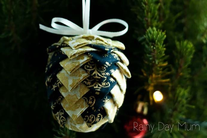 No Sew Fabric Pinecone Ornaments. This craft project doesn't involve any sewing but you will still need to set aside some time. The effect is worth it! Follow the step by step guide on Rainy Day Mum. Please share. Sign up to our craft inspiration roundup newsletter and make Mondays more manageable. Fabulous Crafty ideas and projects delivered to your inbox - CraftyLikeGranny.com #pineconecraft #diy #nosewcraft