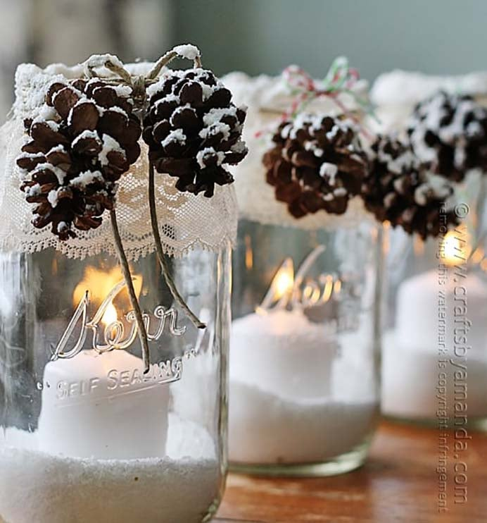 Snowy Pinecone Candle Jars. Crafts By Amanda share their tutorial on how to make pretty winter luminaries that appear to be covered with freshly fallen snow. Using Pine Cones and textured paint, the effect is lovely. Please share. Make Mondays more manageable and sign up for our craft inspiration newsletter. Delivered to your inbox - CraftyLikeGranny.com #pineconecraft #diy #wintercraft #luminaries