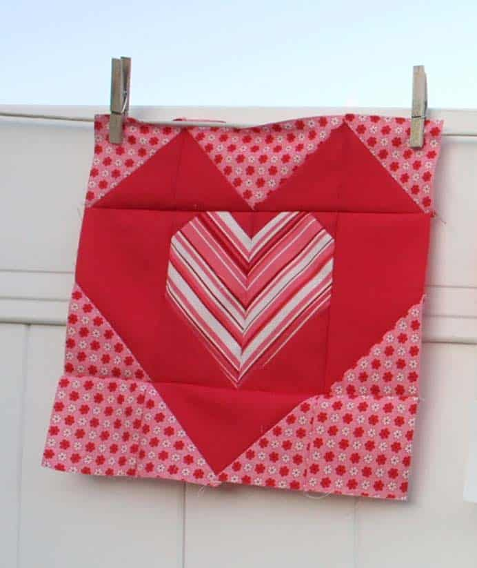 Be Good To Your Heart Quilt Block. Perhaps an ambitious project to make an entire quilt before Valentine's Day. If you love to quilt then follow Amy's tutorial on Diary of a Quilter. Please share and make Mondays fun, get our craft inspiration delivered to your inbox - CraftyLikeGranny.com #valentinesdaycrafts #quiltblock #quilting