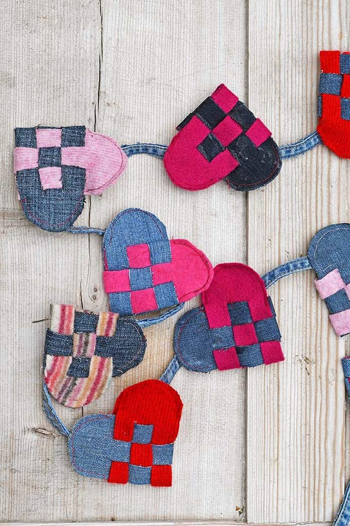 Repurposed Denim and Wool Woven Hearts Garland. Claire from Pillar Box Blue shares her tutorial to make a heart garland from scraps of denim and wool sweaters. A fabulous upcycled idea for Valentine's Day. Please share. Sign up to our craft inspiration roundup newsletter and make Mondays more manageable. Fabulous Crafty ideas and projects delivered to your inbox - CraftyLikeGranny.com #valentinesdaycrafts #craft #diy