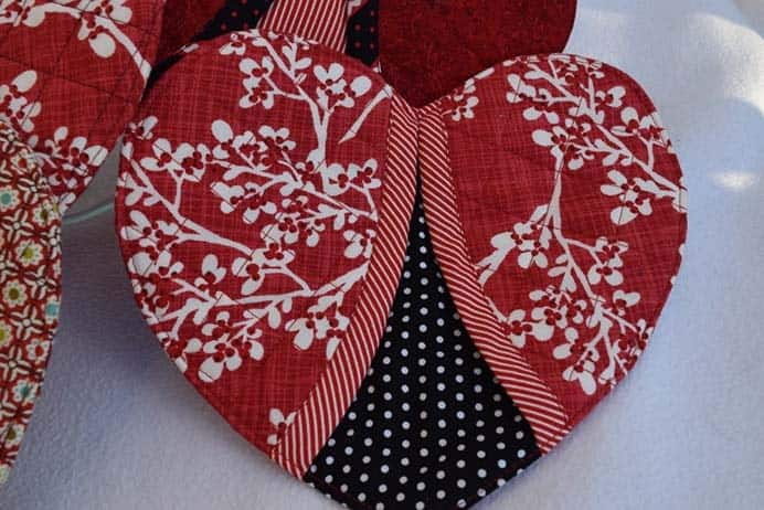 Heart Shaped Pot Holders. Create a heart inspired craft that is functional. Ideas Times Two crafters Cyndi and Betsy share their step by step Oven Mitts tutorial. Please share. Make Mondays more manageable and sign up for our craft inspiration newsletter. Delivered to your inbox - CraftyLikeGranny.com #valentinesdaycrafts #sewing #sewingtutorial