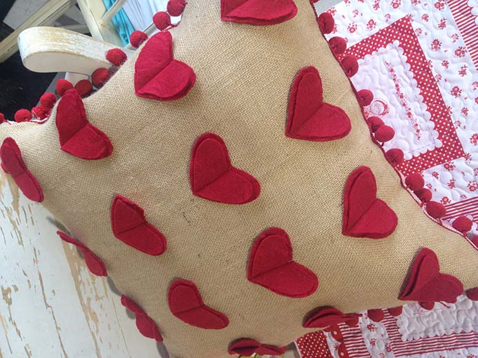 Valentine Heart Pom Pom Pillows Tutorial. Sewing your own pillow covers, is an inexpensive way to update a space and decorate for Valentine's Day. Jen from Tatertots and Jello shares her sewing tutorial. Please share. You will always look forward to Mondays, with our craft inspiration roundups -CraftyLikeGranny.com #valentinesdaycrafts #sewing #sewingpattern