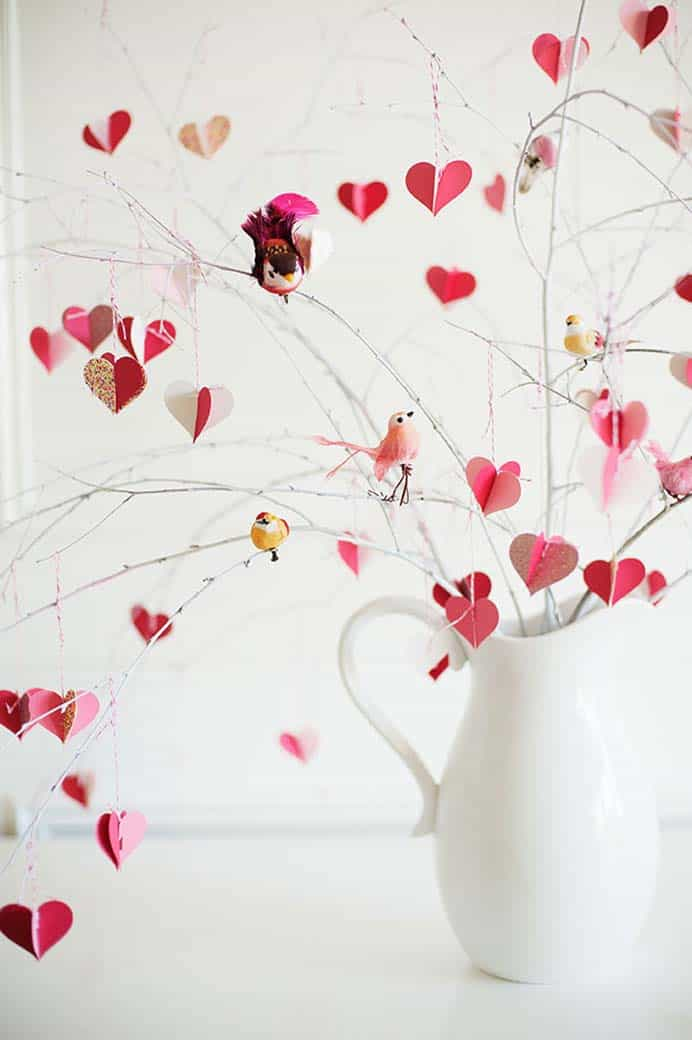 Such a romantic look for your home to celebrate all things 'Love'. Create 3D paper hearts and hang them on branches to place in a large vase or jug. Find the materials list and instructions on The House That Lars Built. Please share. You will always look forward to Mondays, with our craft inspiration roundups -CraftyLikeGranny.com #valentinesdaycrafts #papercraft #homedecor