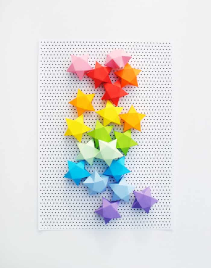 Cut + fold paper stars by Mini Eco