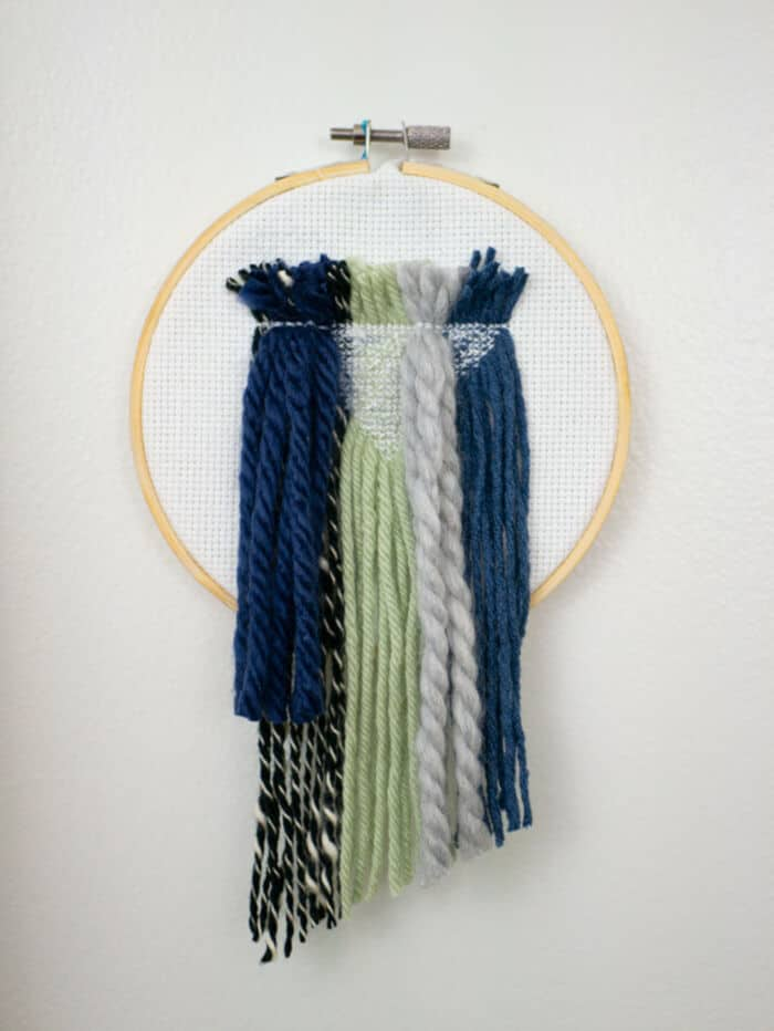 DIY yarn cross stitch wall hanging by The Homesteady