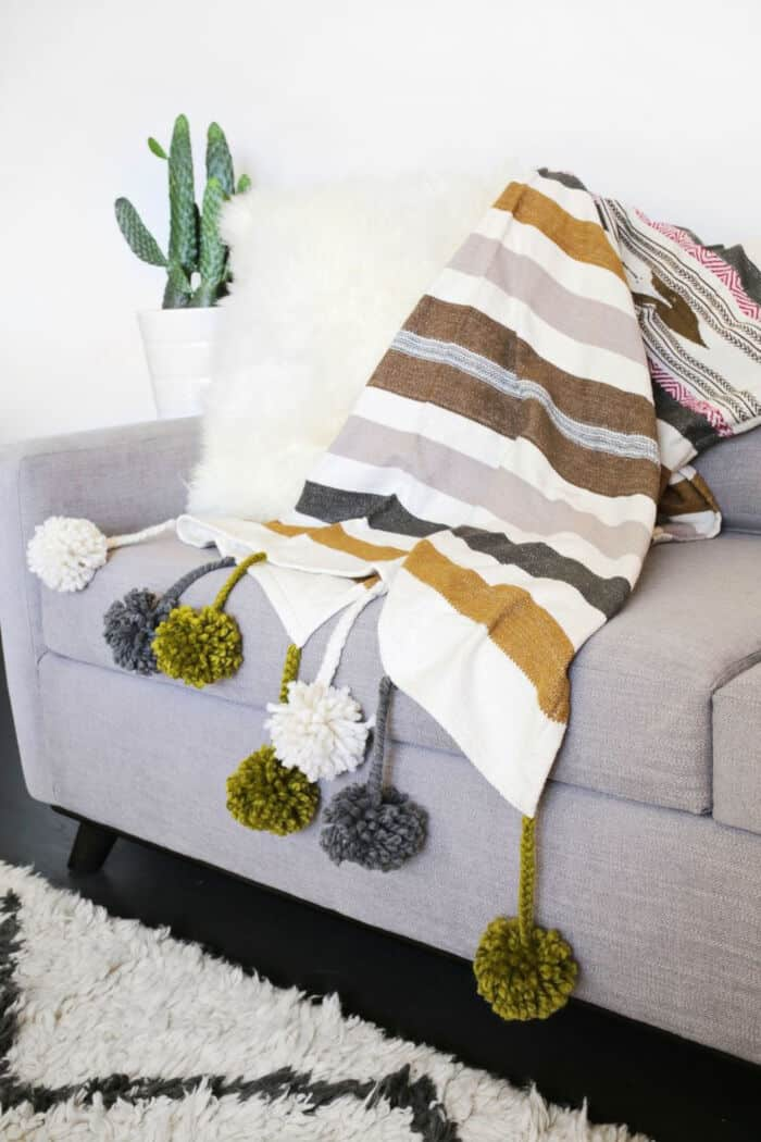 Pom-Pom Blanket DIY by A Beautiful Mess