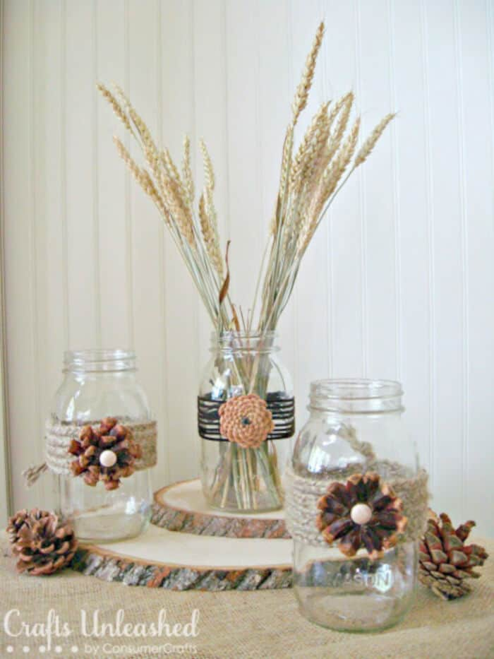 Pine Cone Flower Embellished Mason Jars by Crafts Unleashed