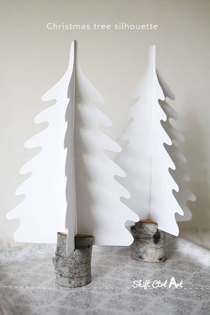 Silhouette Christmas trees in DIY branch holders by A Home for Design