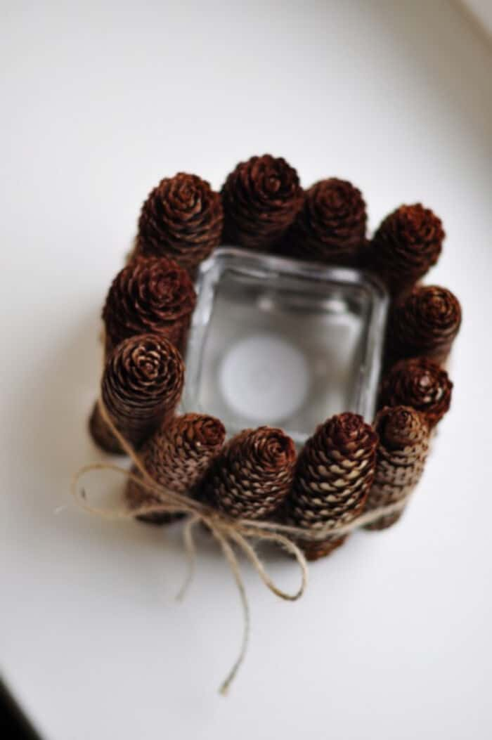 Simple DIY Pine Cone Candle Holder by Shelterness