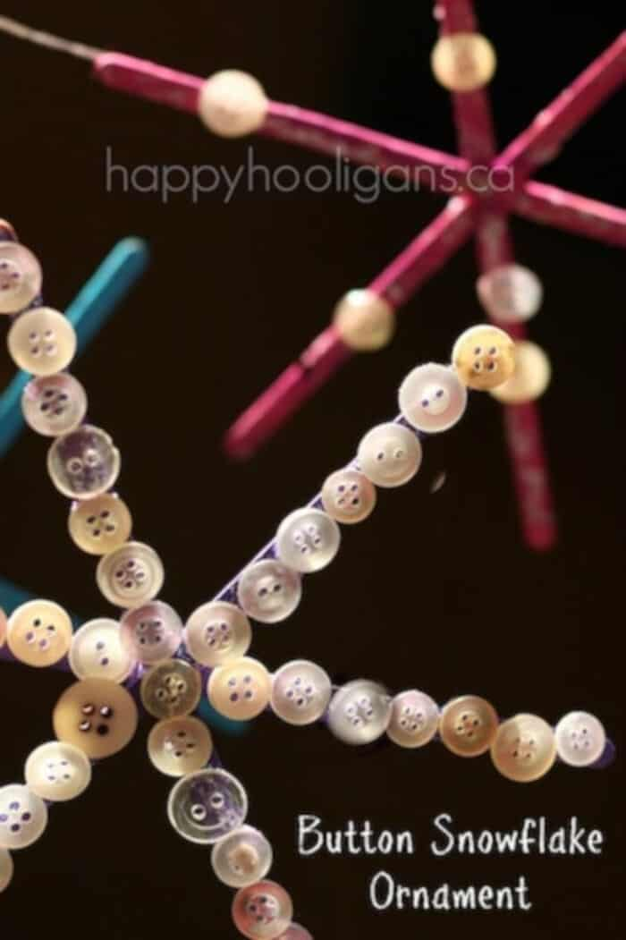 Snowflake-Ornaments-with-Craft-Sticks-and-Buttons-by-Happy-Hooligans